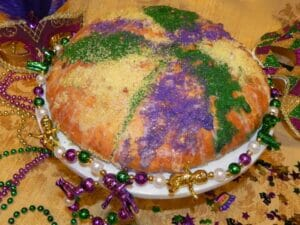 Mardi Gras King Cake, without a hole in the center, due to the dough rising.