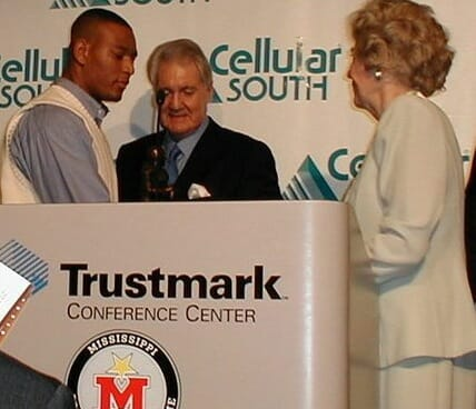 Pat Summerall, center, with Deuce McAllister and Perian Conerly at the 1999 C Spire Conerly Trophy presentation. Photo courtesy of Mississippi Sports Hall of Fame