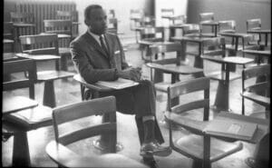 Meredith sits alone in a classroom in 1962.
