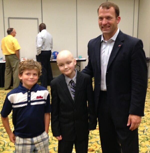 Ole Miss Athletic Director Ross Bjork (right) was the featured speaker at the benefit. He is joined by his son Payton (left) and Chance Tetrick (center). Photo courtesy of Evelyn VanPelt