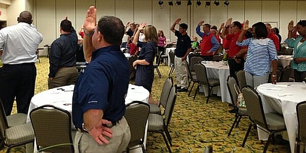 """Ross Bjork asked guests to rise and do the """"Fins Up"""" for Chance. Photo courtesy of Evelyn VanPelt"""