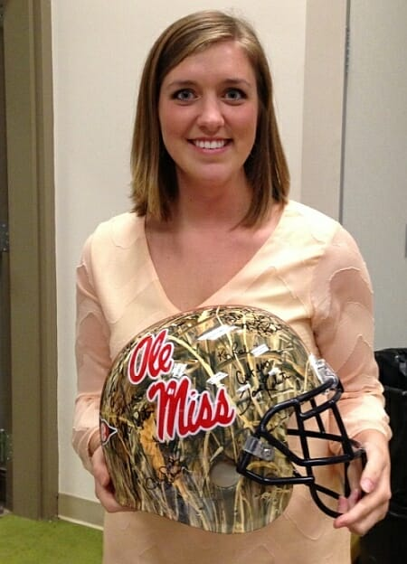 Dr. Hayden Perkins' loyal employee attended the benefit and took home the Ole Miss Duck Dynasty helmet for her boss. Photo courtesy of Evelyn VanPelt