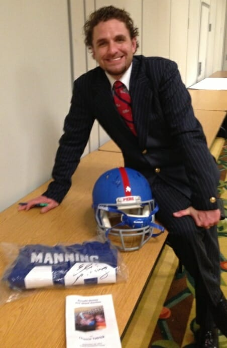 Chris Jones purchased a signed Eli Manning jersey and an autographed Dexter McCluster helmet. Photo courtesy of Evelyn VanPelt