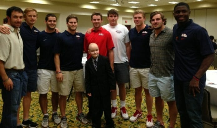Rebel Football players joined Chance Tetrick at a benefit in his honor. Photo courtesy of Evelyn VanPelt