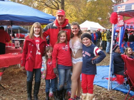 Norma and David McCullough, with their three nieces Jade, CJ and Olivia, took a picture with Rebel twirler, Jessica Haney at the Missouri Game. The McCulloughs and Haney are all from West Memphis, Arkansas.