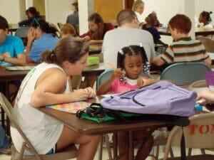 Image of tutors helping students courtesy of the Leap Frog Program's website: www.leapfrogprogram.org