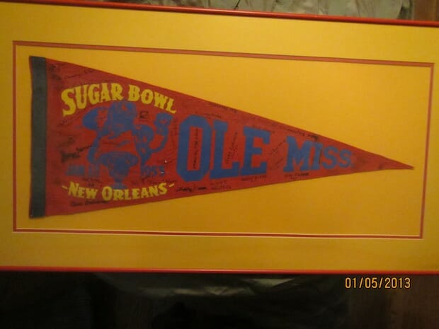This pennant was found in an antique shop in Chicago, this 1955 Sugar Bowl pennant signed by most Ole Miss players was purchased by Larry Meek and given to his older brother, Ed, who has passed it down to grandson, John Hale Houston