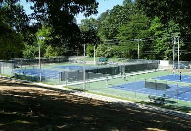 Four greatly modernized lighted tennis courts - Photo courtesy OPC