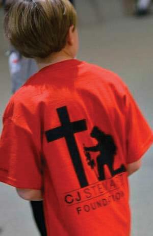 Boy in a CJ Foundation t-shirt
