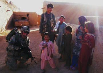 CJ with Afghan children