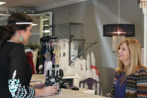 Lauron Mills, owner of Monarch Boutique, and Reid discuss advertising strategy for the North End Project.