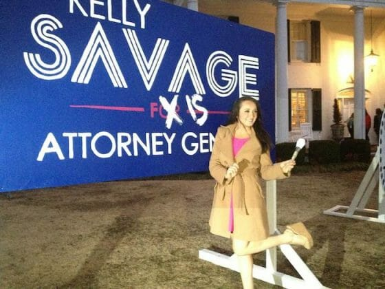 Attorney general elect Kelly Savage edits her campaign sign after results are announced.
