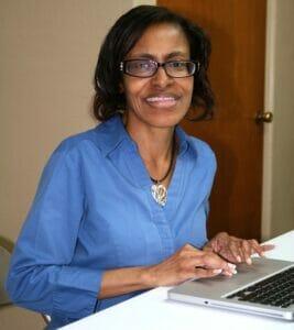 GED instructor Barbara Worthum starts up one of the new Burns UMC computers.