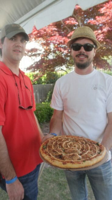 Preston Lott and Brooks Roberts of Lost Pizza Co. and their pie.