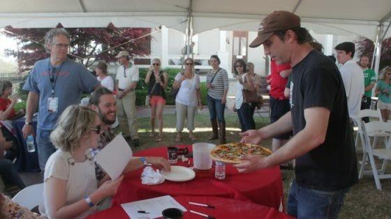David Tieman of Five Points Pizza presents his pizza to the judges.