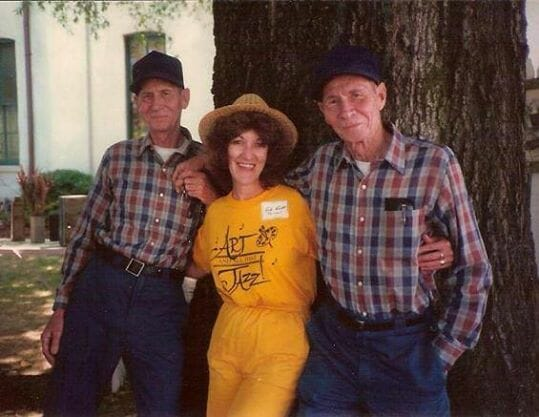 """Visiting here on the Courthouse lawn at that first festival is Crockett with Oxford icons Edmund and Ephraim Lowe. The brothers played the Gowrie twins in MGM's motion picture of William Faulkner's, Intruder in the Dust. Evelyn recalls, """"I was the only woman to come between the Lowe brothers!"""""""