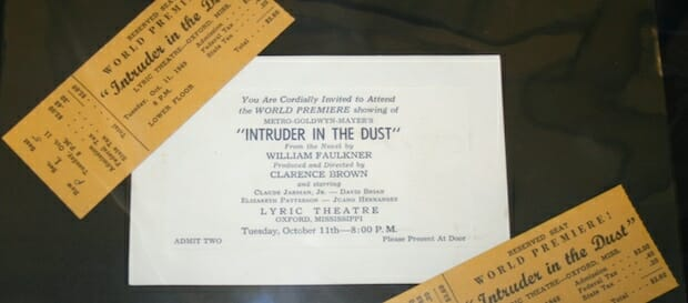 Each case includes artifacts from Faulkner's life regarding a particular book, such as these tickets to the Intruder in the Dust movie that premiered at the Lyric Theater.
