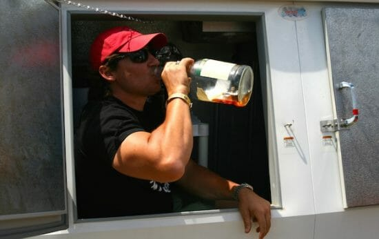 Jack Koban demonstrates the Magically Piglicious shot in the cooler. Every member of the team traditionally climbs in Saturday before judging to take a shot of whiskey.