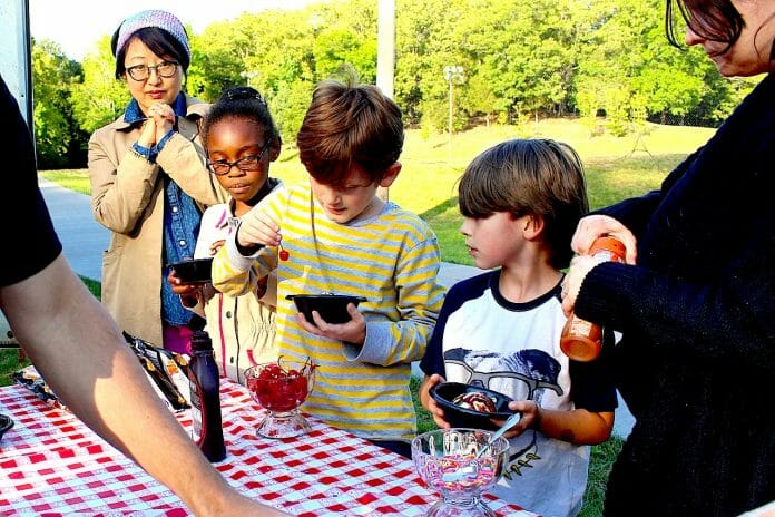 Youngsters enjoy some ice cream with their picnic.