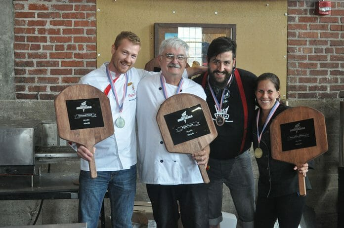 Greg Riviotta, Rick Mines, Chris Mallon and Karen Irby were the top pizza makers in the Slice of Americana competition held on the Fourth of July in Oxford. Photo by Kara Hoffman, PMQ Pizza Magazine.