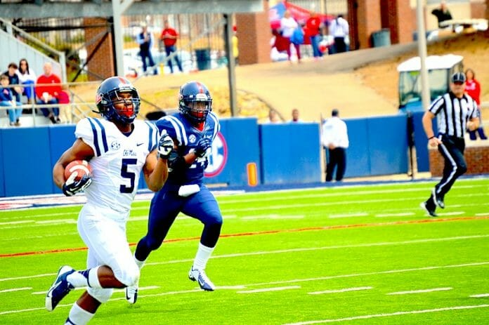 I'Tavius Mathers runs for a touchdown in the Grove Bowl