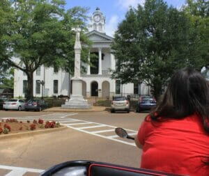 Ashley Hoffner pedals by the Courthouse. Photo taken 8/12/14.