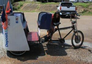 Ashley Hoffner prepares the rickshaw.
