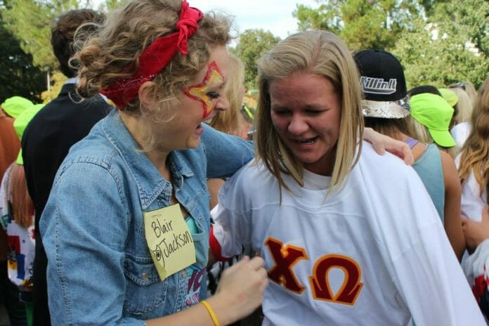 Blair Jackson and Hannah Sellers celebrate after Sellers received her Chi O bid.