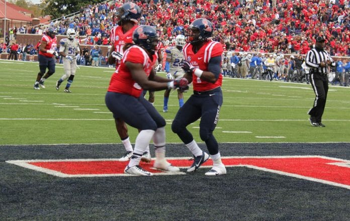 Rebel players celebrate with Vince Sanders after his 23 yard dash for a TD.