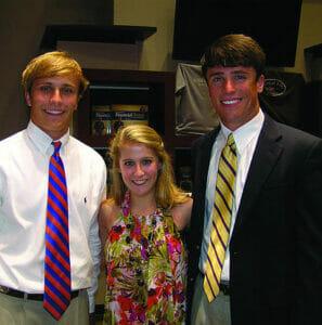 Davis' children, from left, Ken Harp, Leah and John Kyle.