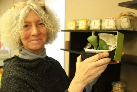 Patsy Engelhard, owner of Knit 1 Oxford, poses with Gianna Rose Atelier's Magical Frog priced at $26.
