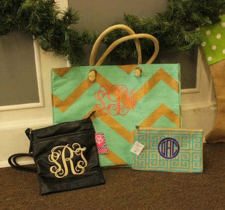 (from left) Crossbody purse $30, Chevron Juco Tote $27.95, and Cosmetic bag $9.95