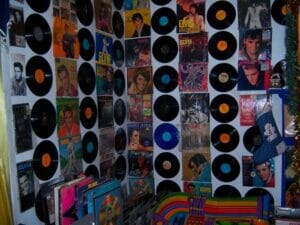 Every room in the house was covered floor to ceiling in Elvis Presley records, newspapers, concert posters and more. Photo by Amelia Camurati