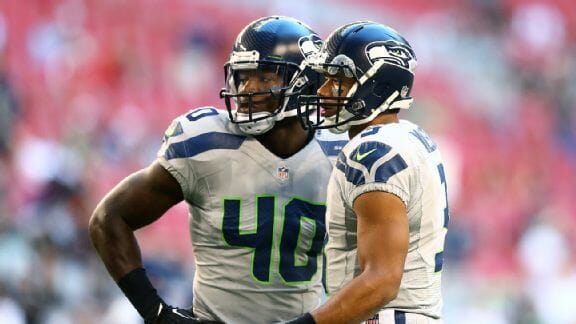 Derrick Coleman with Russell Wilson,  photo by Mark J. Rebilas of USA TODAY Sports