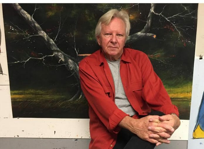William Dunlap's work has been on display in such renowned locations as the Metropolitan Museum of Art in New York and the Corcoran Gallery of Art in Washington, DC. Here, is is pictured with one of his oil paintings.