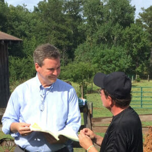 Executive producer Sam Haskell (left) on the 'Colors' set with director Steve Herek