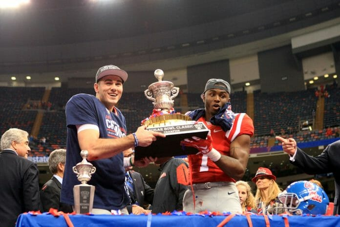 Chad Kelly and Laquon Treadwell had the honors of holding the Sugar Bowl trophy. Photo by John Bowen.