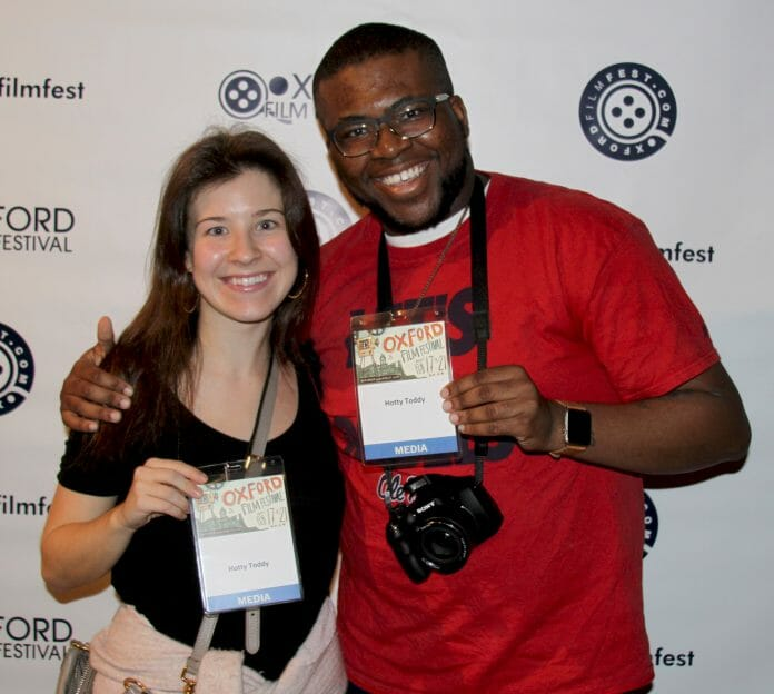 HottyToddy.com interns Hannah Pickett (left) and Christopher Neal take a break for a photo op at Oxford Film Festival's red carpet event at the Lyric Oxford. Photo by Jeff McVay