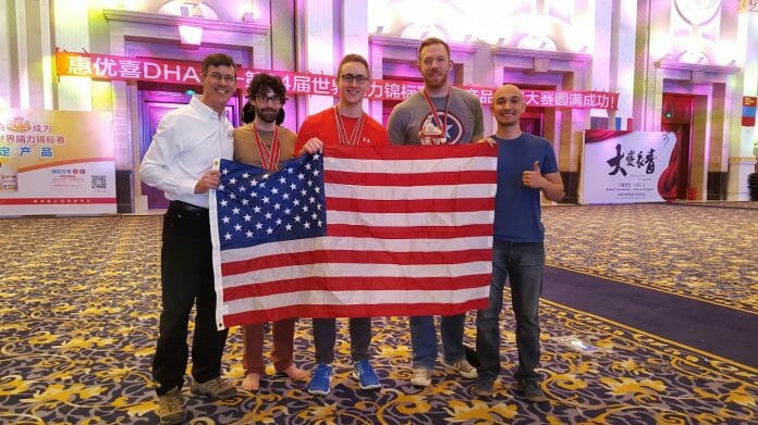 The US memory team poses with the American flag after finishing second overall at the 2015 World Memory Championships behind Germany. The USA's previous best was fifth. From left: Brad Zupp, Lance Tschirhart, Alex Mullen, Nelson Dellis, Luis Angel.