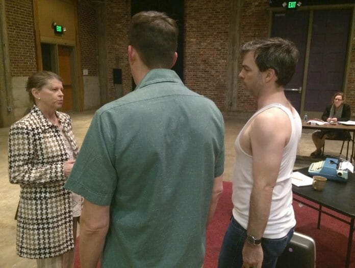 Actors Susan Hickman, Brian Whisenant and Greg Earnest rehearse a scene from 'True West' while director Kate Hooper looks on.