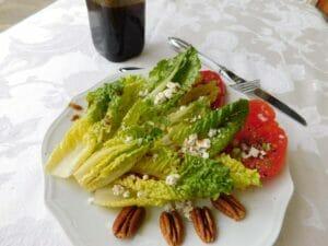 A salad covered in balsamic vinaigrette.