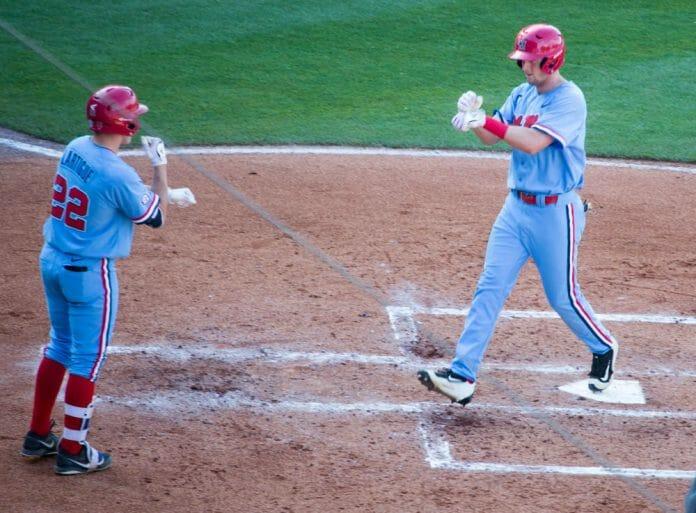 J.B. Woodman and Henri Lartigue celebrate J.B.'s solo home run.
