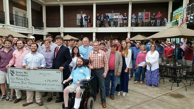 The Epsilon Xi chapter of Sigma Nu fraternity presents $75,000 to Kevin Orr.