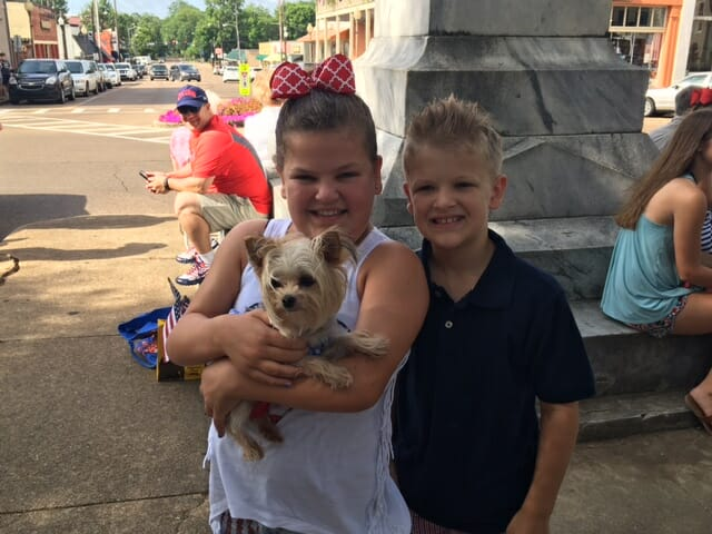 Maci and Tyler Haywood waited for the parade with their dog, Delilah.