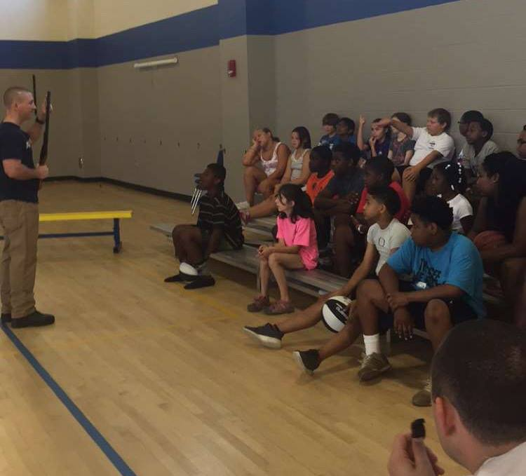A police officer showed the campers what a firearm is and instructed them on its dangers and proper use. (Picture from Facebook.com/ Oxford MS Police Department)
