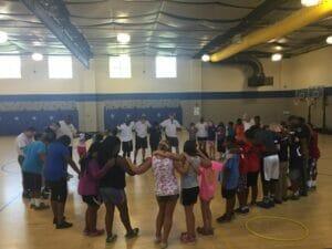 Camp COPS began with a prayer circle.