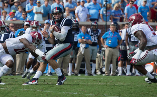 Chad Kelly is caught in the backfield by Alabama's Reuben Foster (10) and DaShwan Hand (9) at Vaught-Hemmingway stadium Saturday during the Ole Miss v Alabama game.